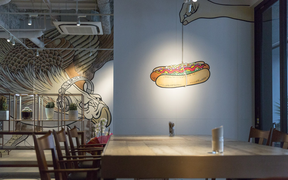 wall art of hot dog on a string