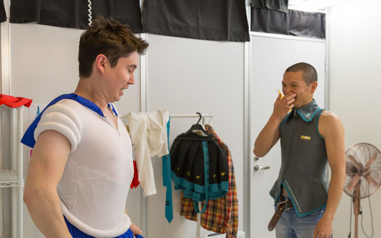 two men getting dressed in cosplay at studio crown