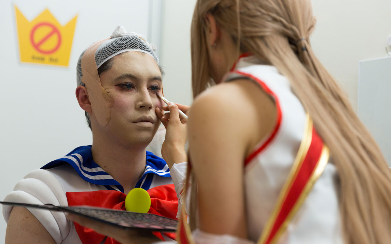 man in cosplay getting makeup