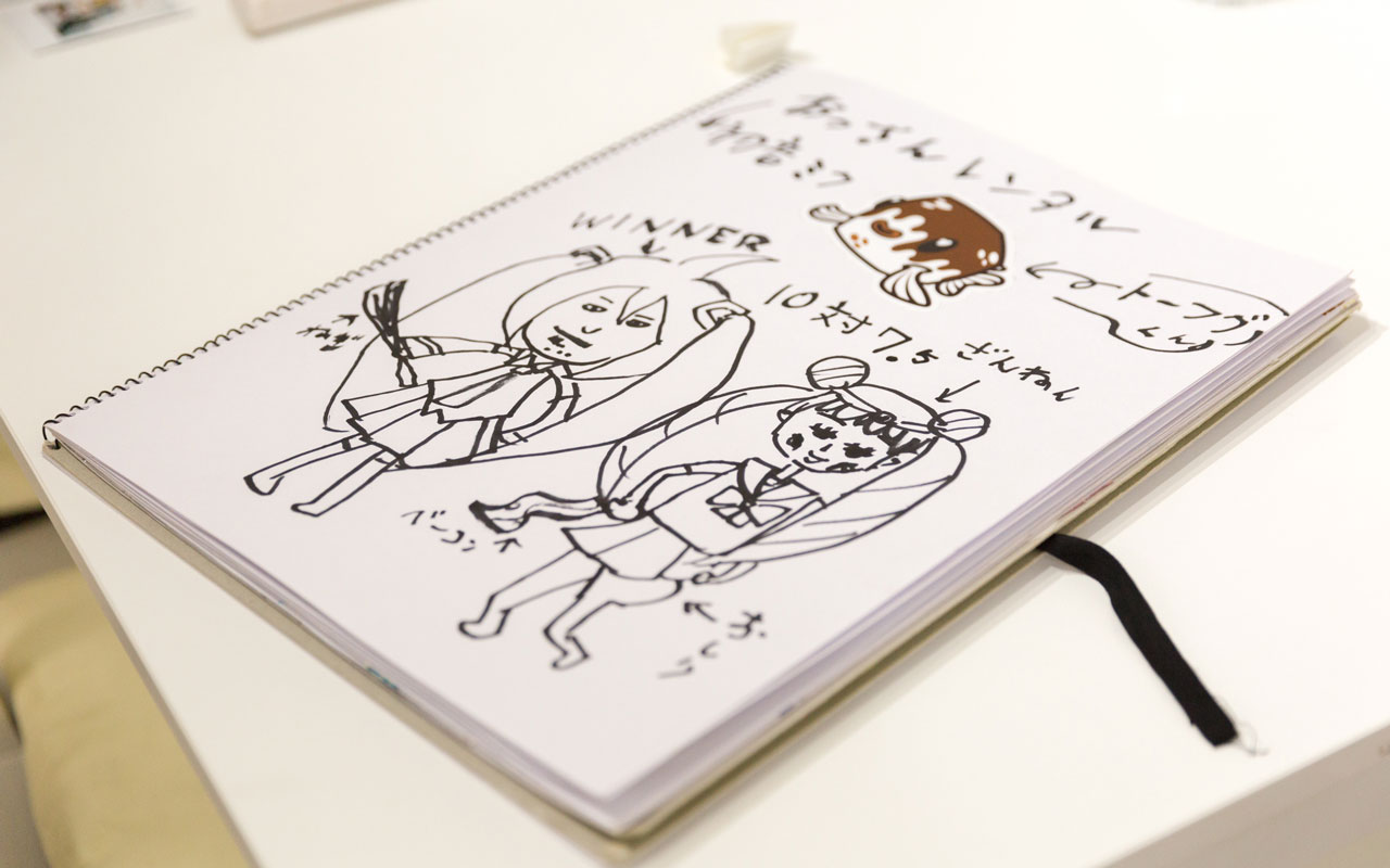 cartoon drawing in a notebook