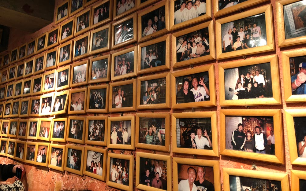 wall of celebrity photos at yakiniku meimon in shinjuku