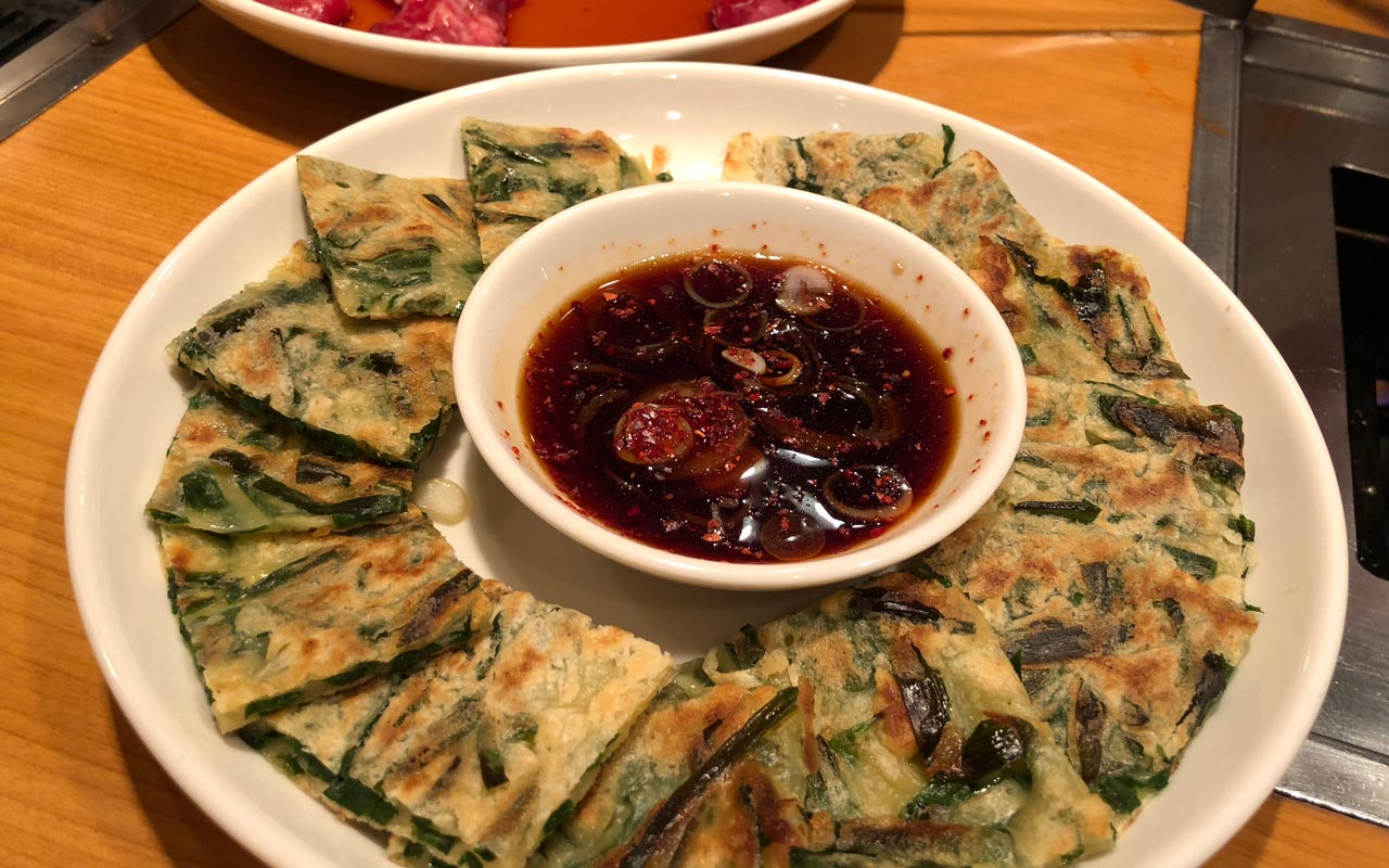 plate of korean chijimi pancake with sauce