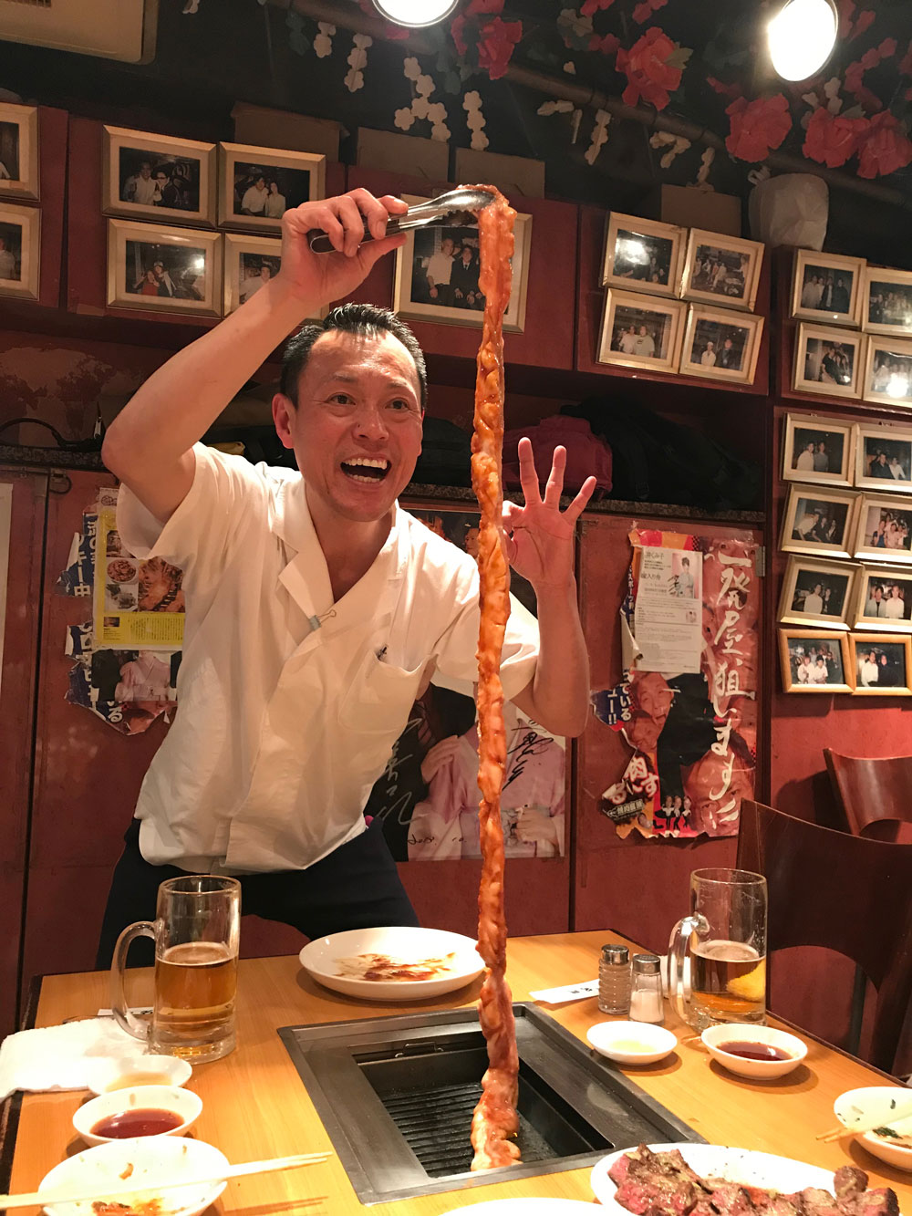 yakiniku meimon spokeman yakki holding meter long cow intestine