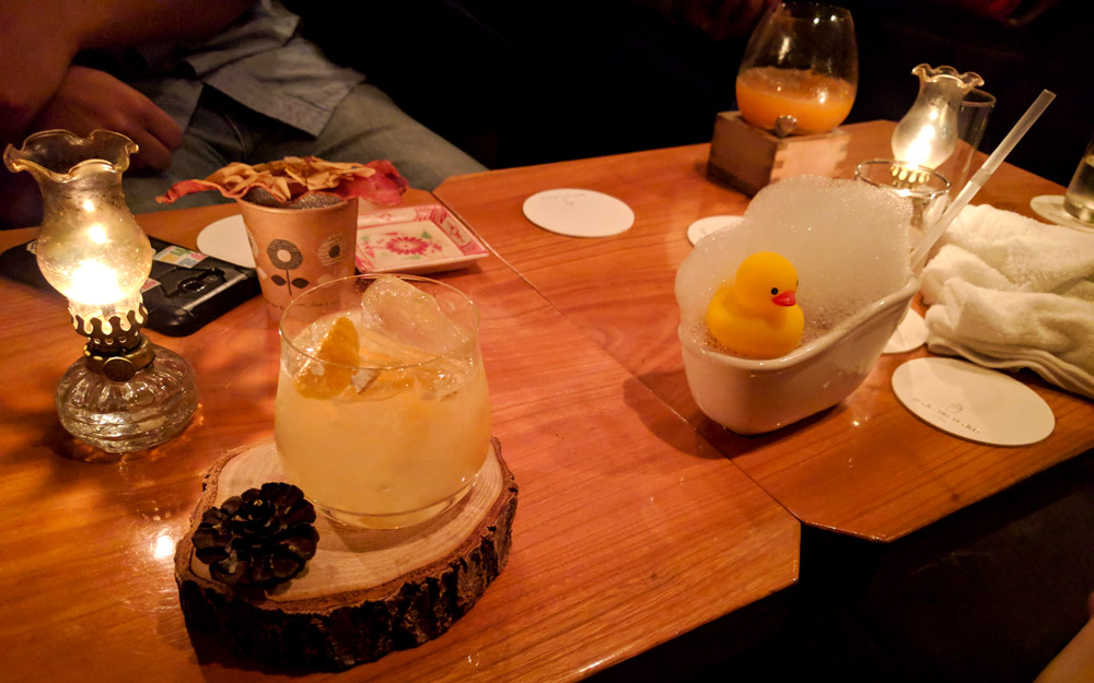 various cocktails on a table at bar orchard