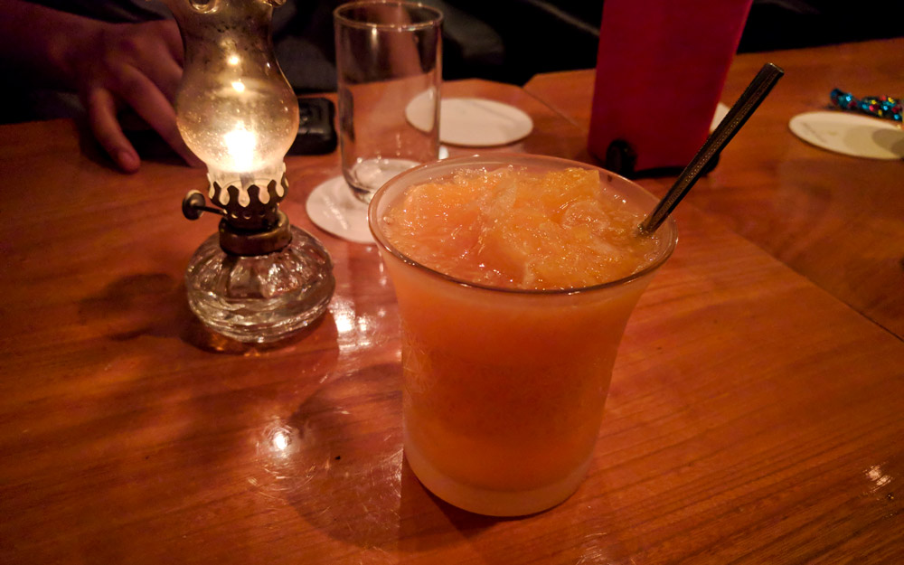 orange flavored cocktail at bar orchard