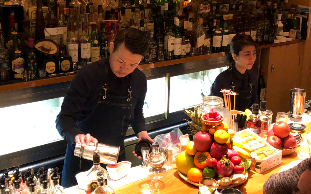 bartenders at bar orchard mixing drinks