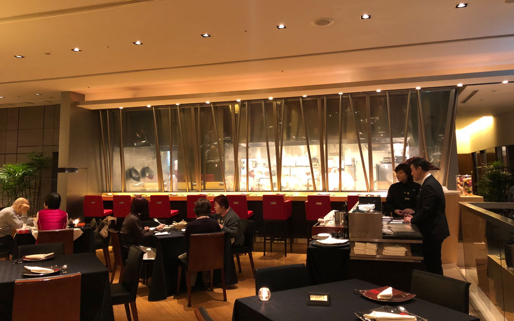 people eating in dining room at iron chef restaurant