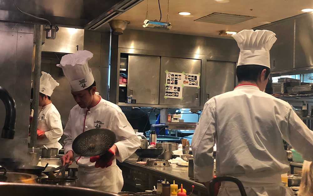 chefs working in kitchen at iron chef restaurant