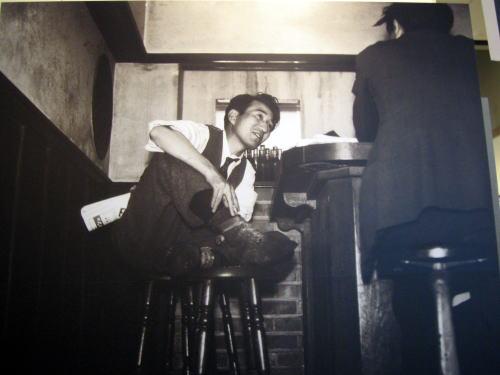 famous photo of dazai osamu drinking at bar lupin