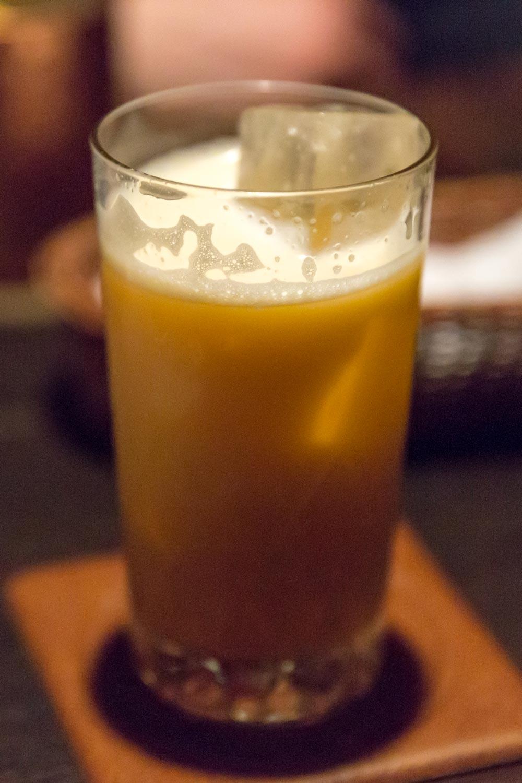 golden fizz cocktail served at bar lupin