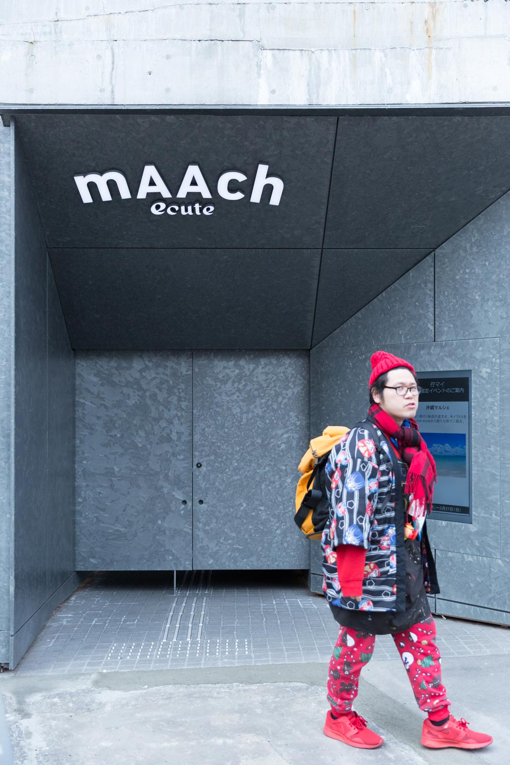 homeless kotani in front of maach ecute