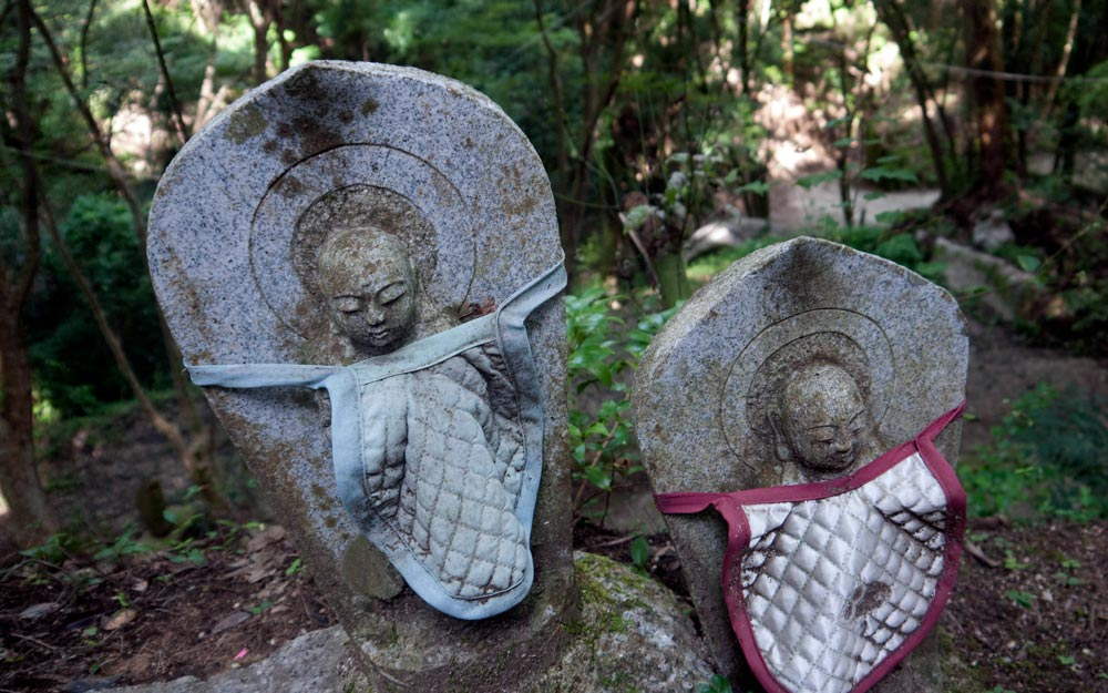old jizo statues with bibs