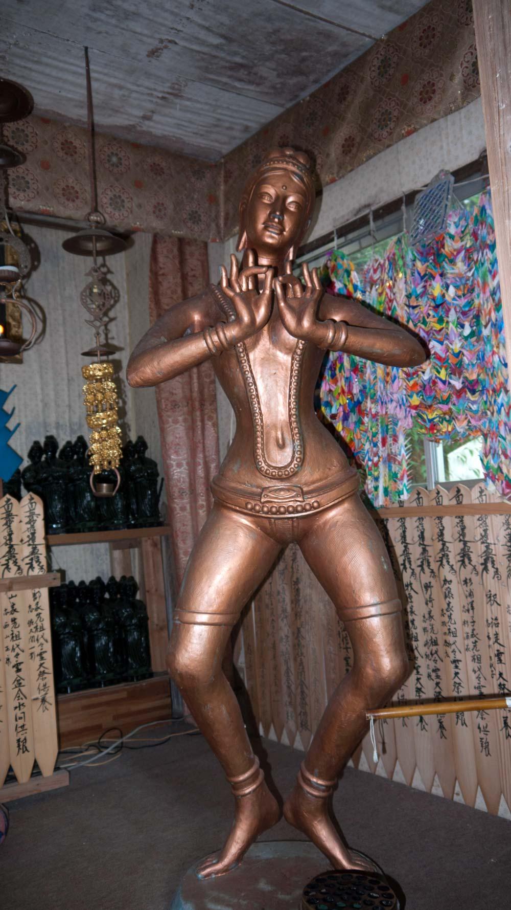 kannon statue in a strange pose