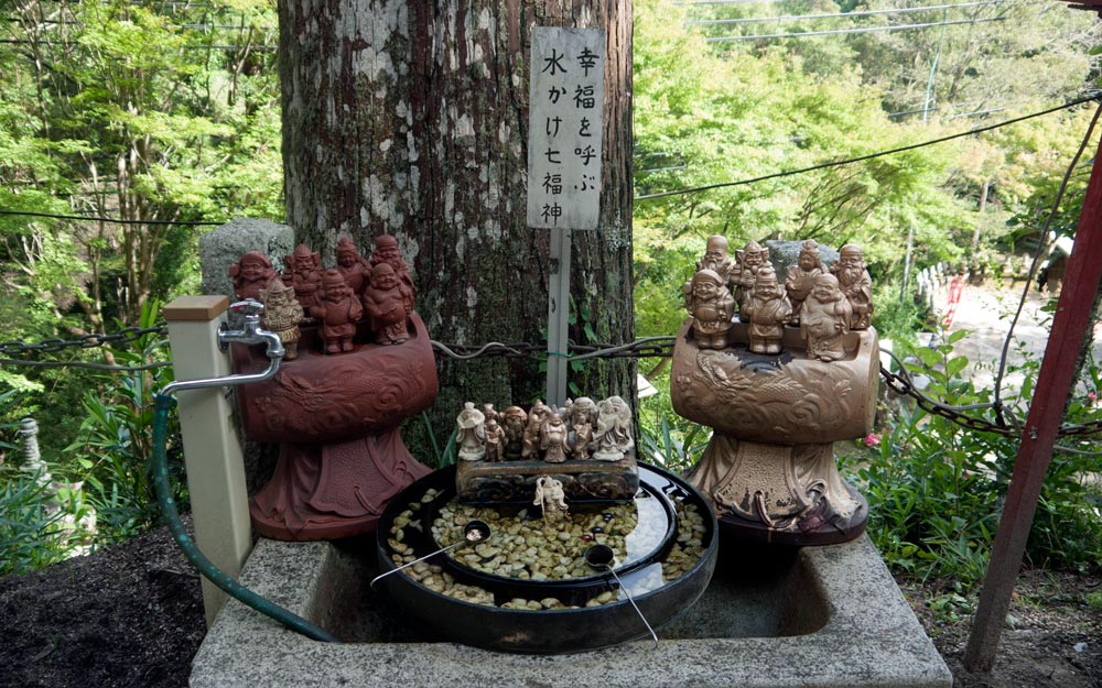 statues of seven lucky gods at water basin